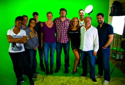 Malibu film crew posing in green screen studio